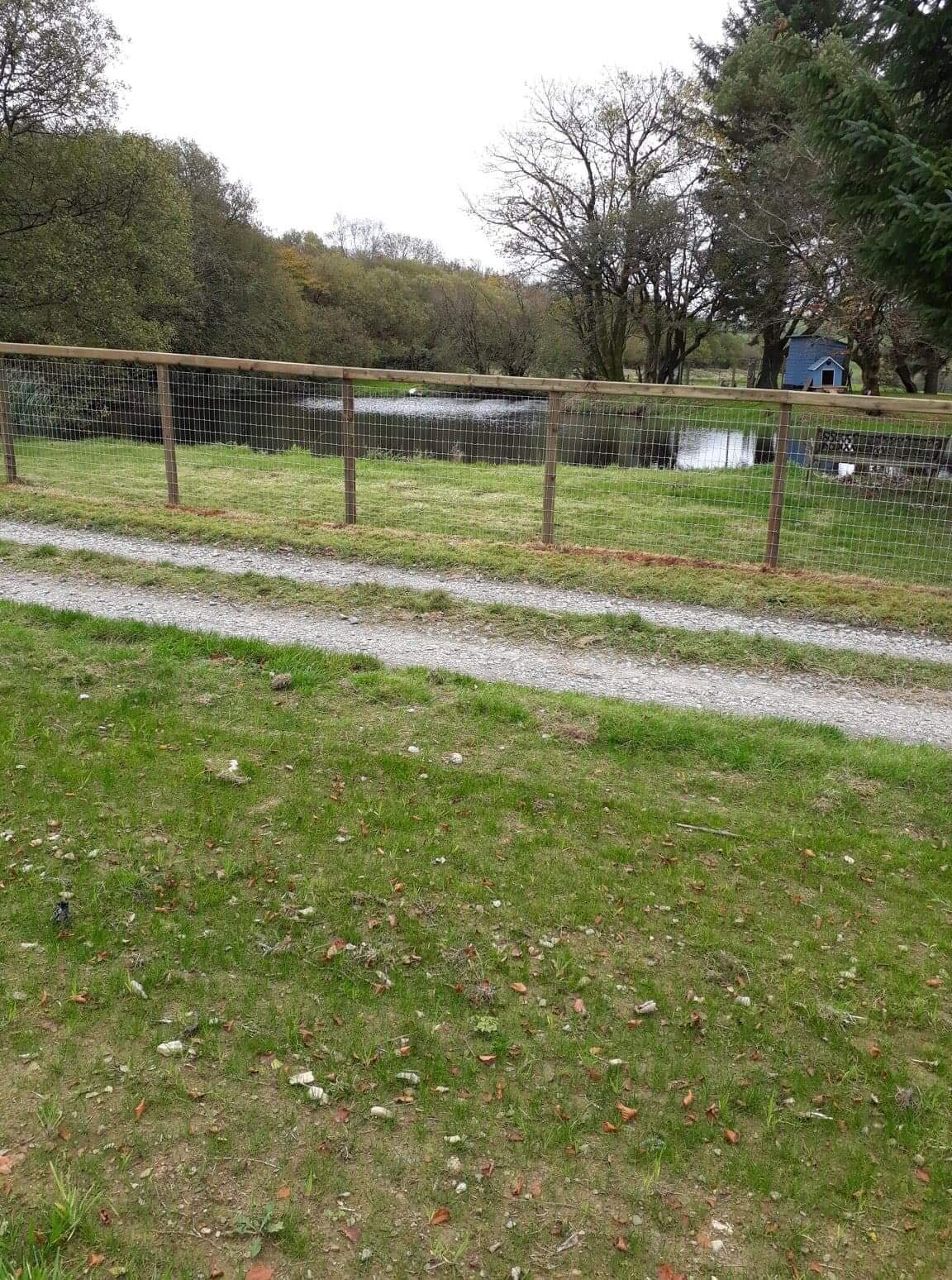 Post and wire fencing  around pond