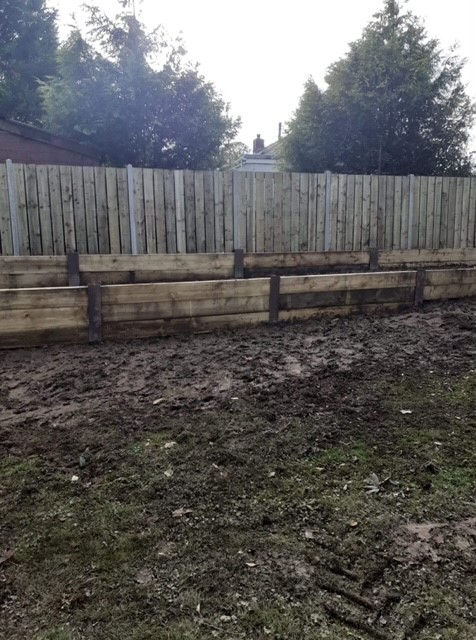 Clearly see the raised bed against the fencing.