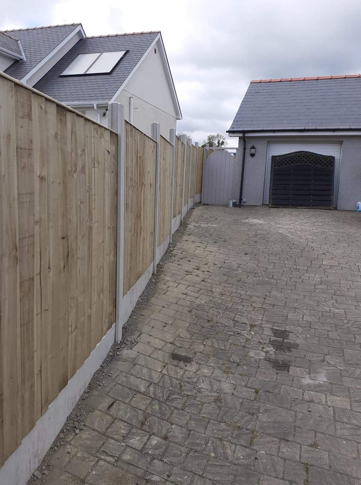 Natural panel fencing in concrete base by West Wales Panels and Groundworks