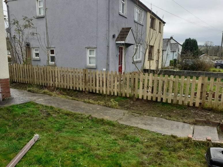 Wooden Picket Fence between properites