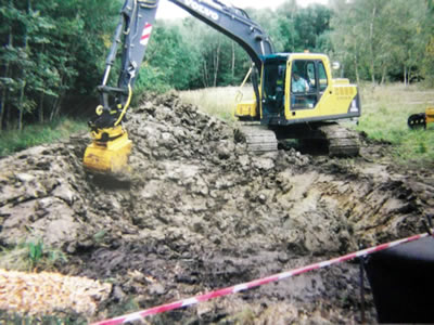 Digging to create a pond by West Wales Panels and Groundworks.